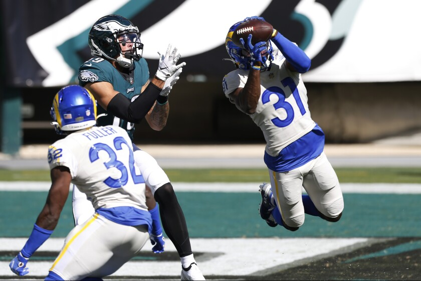 The Rams' Darious Williams intercepts a pass intended for Philadelphia Eagles' J.J. Arcega-Whiteside last season.