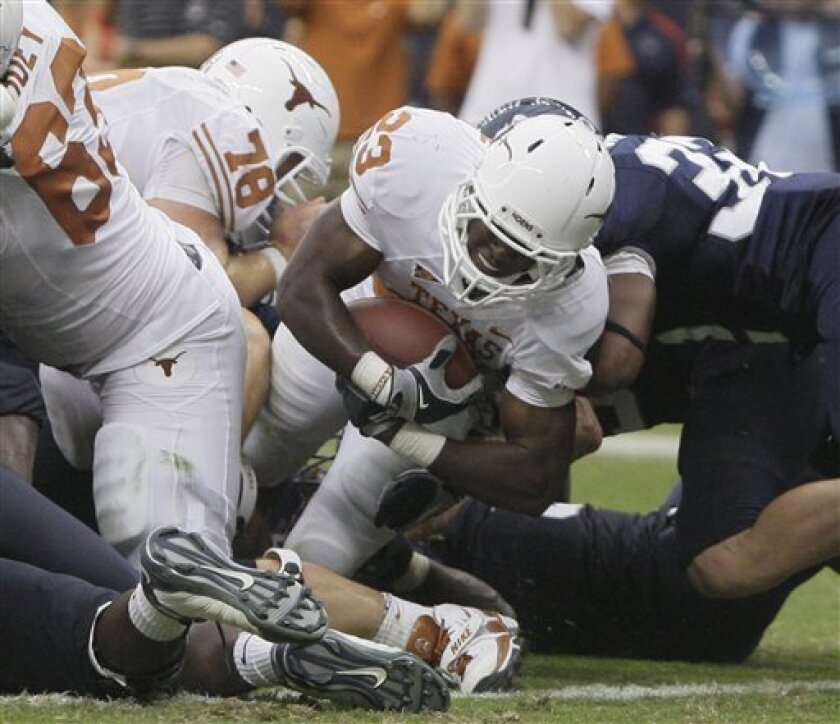 Texas running Tre' Newton dives in to score during the second half of an NCAA football game against Rice, Saturday, Sept. 4, 2010 in Houston. Texas won 34-17. (AP Photo/Pat Sullivan)