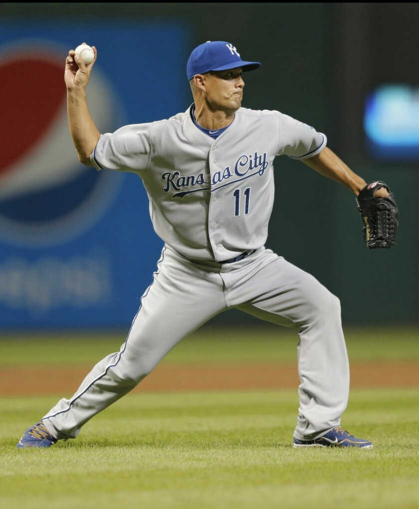Kansas City Royals relief pitcher Jeremy Guthrie throws out Cleveland Indians' Jason Kipnis at first base after a bunt in the fourth inning of a baseball game, Wednesday, Sept. 16, 2015, in Cleveland. (AP Photo/Tony Dejak)