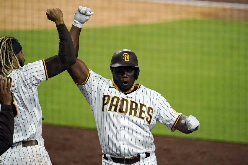 San Diego Padres' Jorge Ona, right, reacts with teammate Fernando Tatis Jr. after hitting a home run during the fourth inning of a baseball game against the San Francisco Giants, Thursday, Sept. 10, 2020, in San Diego. (AP Photo/Gregory Bull)