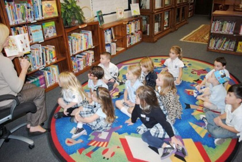 Ms. Jamie's Class of Lion Cubs explores Horizon Prep's 7,000 volume library and hears from librarian Kelly Hendrickson at Kindergartner for a Day! Payton Urie, Madelyn Pradels, Jagger Goulart, Donovan Sweeney; (Next row) Addyson Arner, Madison Haywood, Tate Oakley; (Next row) Britta Brekke, Jensen