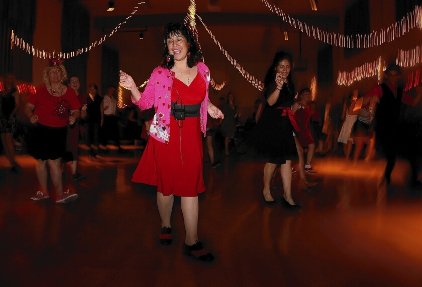 """Erin Stevens, swing dance instructor and co-owner of the Pasadena Ballroom Dance Assn., says while learning to lead and follow, """"you are using your brain paths."""""""