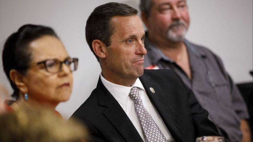 Rep. Steve Knight (R-Palmdale) listens to a speaker while campaigning for congress during a luncheon