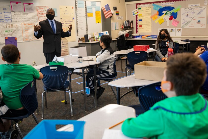 State Superintendent Tony Thurmond speaks to fourth-grade students at Castle Park Elementary School on Thursday.