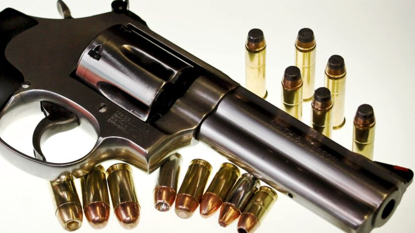 In a Saturday, Aug. 22, 2009 photo, a Smith & Weston .357 is shown with various caliber handgun ammu