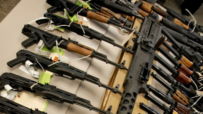 A cache of seized weapons displayed at a news conference in Phoenix.
