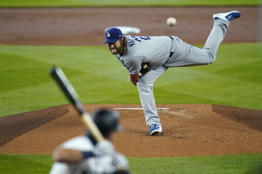 Dodgers starting pitcher Clayton Kershaw throws to Seattle's Dylan Moore.