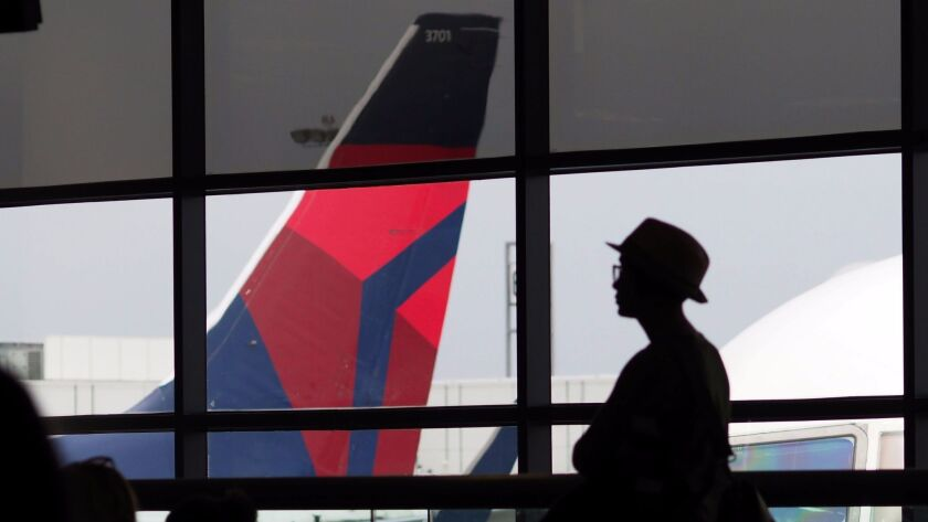 A passenger waits for a Delta Airlines flight.