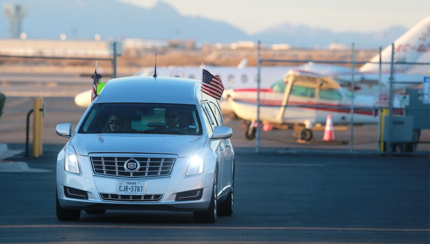 The hearse which transported Supreme Court Justice Antonin Scalia's body to the airport from Sunset Funeral Home departs the Atlantic Aviation hangar at El Paso International Airport in El Paso, Texas, Sunday, Feb. 14, 2016. (VIctor Calzada/The El Paso Times via AP) MANDATORY CREDIT