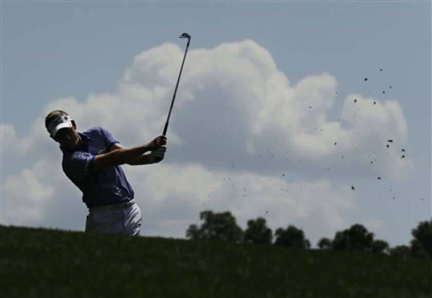 Luke Donald, of England, hits off the fourth fairway during a practice round for the Masters golf tournament Tuesday, April 9, 2013, in Augusta, Ga. (AP Photo/Charlie Riedel)