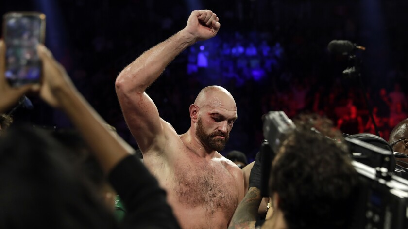 Tyson Fury celebrates after defeating Otto Wallin in a unanimous decision Sept. 14, 2019.