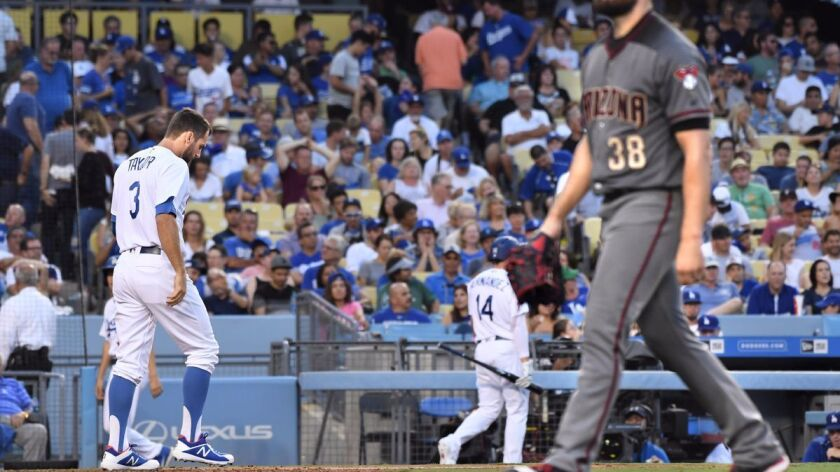 Dodgers outfielder Chris Taylor walks away after striking out in the sixth inning against the Arizona Diamondbacks pitcher Robbie Ray at Dodger Stadium on Monday.