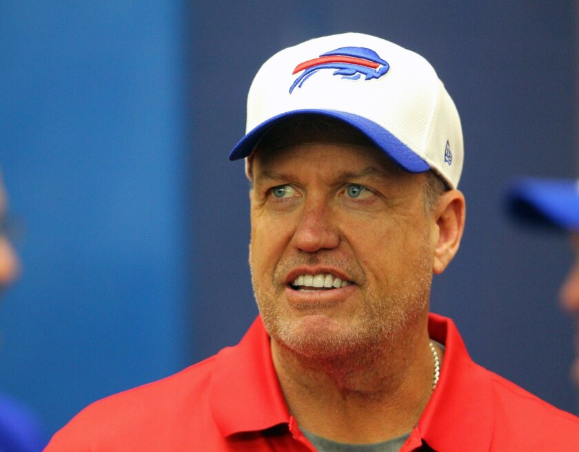 FILE - In this May 9, 2015, file photo, Buffalo Bills head coach Rex Ryan reacts during an NFL football rookie minicamp in Orchard Park, N.Y. (AP Photo/Bill Wippert, File)