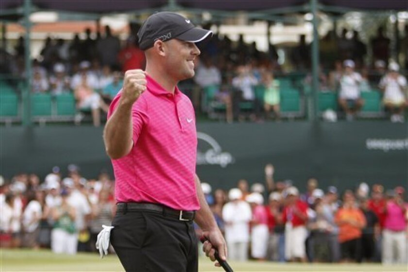 U.S. Scott Brown celebrates after making a bird in the 18th hole during the Puerto Rico Open PGA golf tournament final round in Rio Grande, Puerto Rico, Sunday, March 10, 2013. (AP Photo/Ricardo Arduengo)