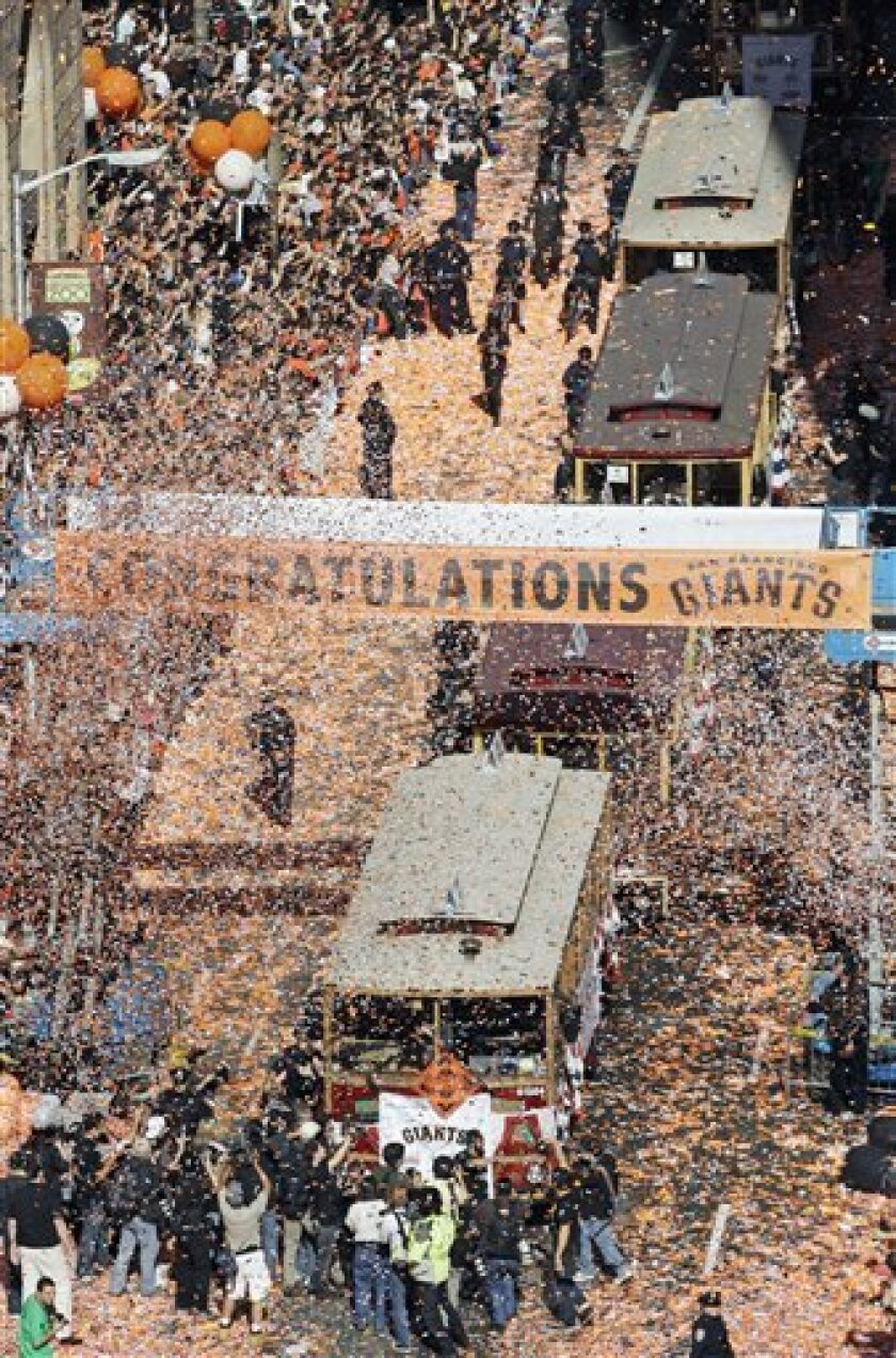 Motorized cable cars ferrying the San Francisco Giants make their way during a ticker-tape parade celebrating their baseball World Series win, Wednesday, Nov. 3, 2010 in San Francisco. The Giants defeated the Texas Rangers in five games for their first championship since the team moved west from Ne