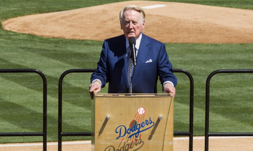 Longtime Dodgers announcer Vin Scully leads a eulogy for the late Dr. Frank Jobe during a memorial service at Dodger Stadium on Monday.
