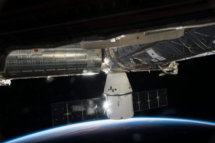 SpaceX's Dragon cargo capsule is docked to the Earth-facing port of the Harmony module of the International Space Station in May. On the Dragon cargo ship's next flight in June, the rocket disintegrated two minutes after liftoff.