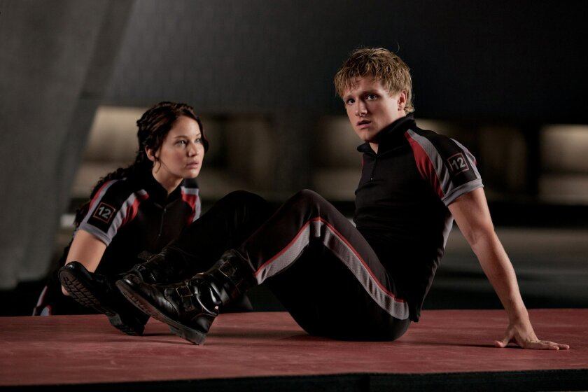 MOVIE---Katniss Everdeen (Jennifer Lawrence) and Peeta Mellark (Josh Hutcherson) in THE HUNGER GAMES. Photo credit: Murray Close