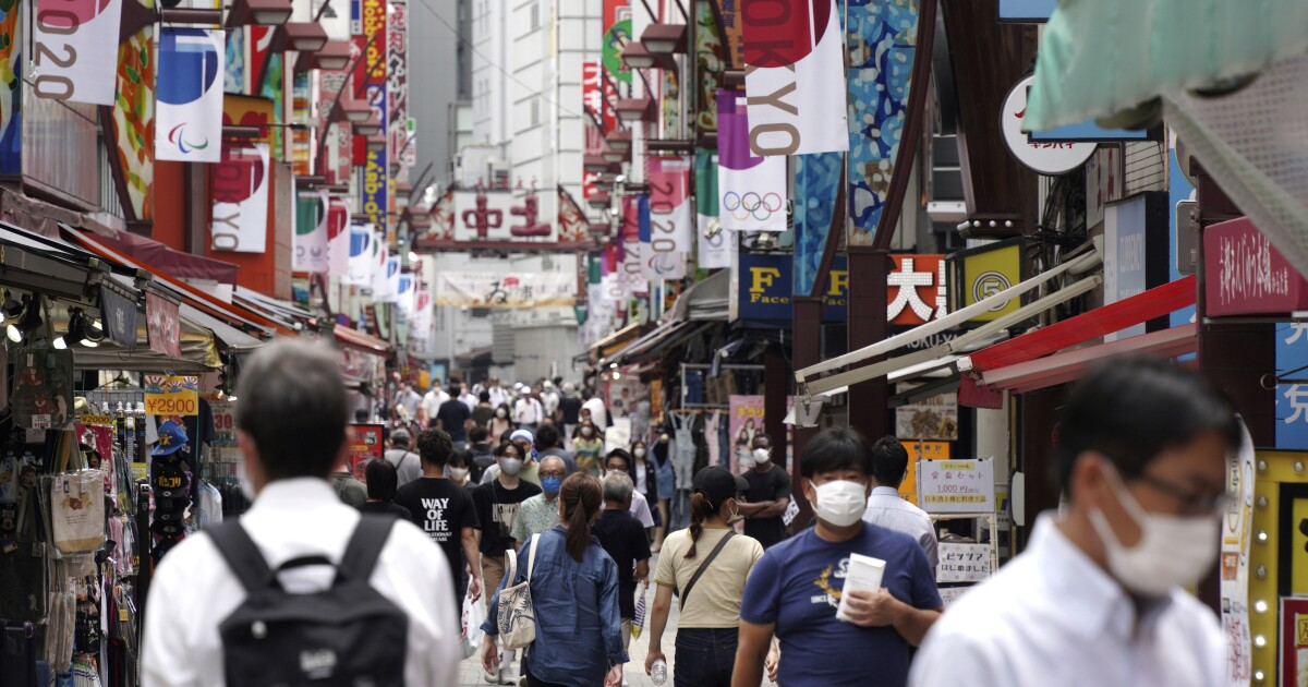 Japan expands coronavirus emergency after record spikes amid Olympics