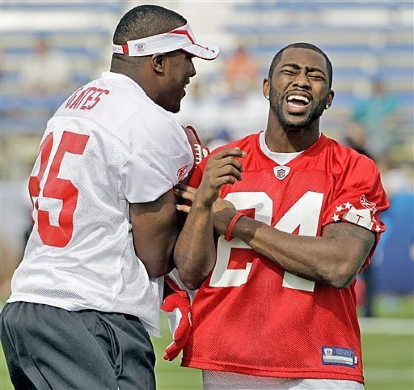 Chargers tight end Antonio Gates (left) and Jets cornerback Darrelle Revis have some fun during a practice for tonight's Pro Bowl in Fort Lauderdale, Fla. Gates has been selected to each of the past six all-star games.