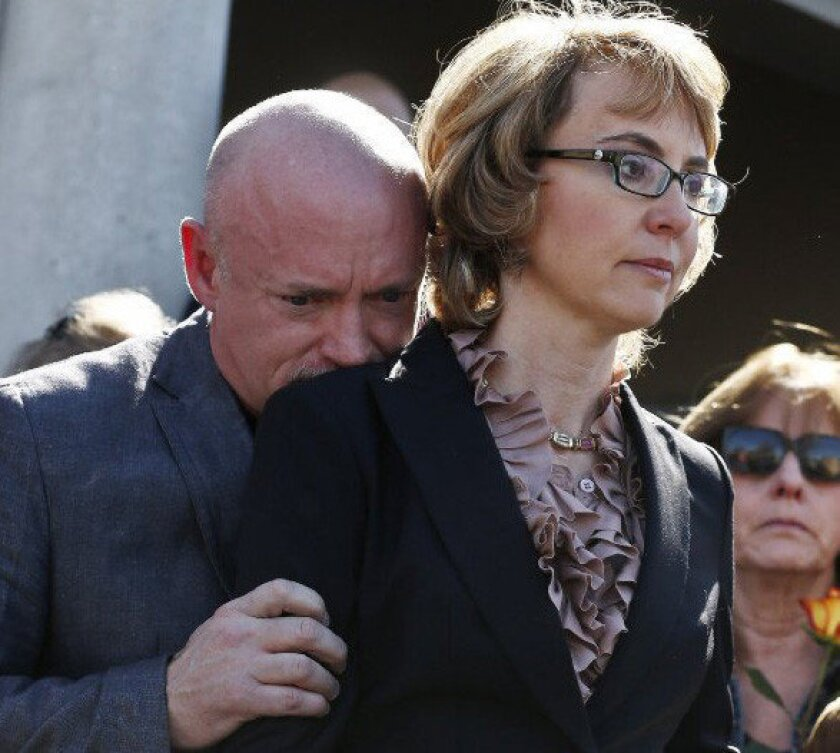 Former Rep. Gabrielle Giffords, right, with her husband Mark Kelly at a Tuscon rally in support of expanded background checks on gun control.