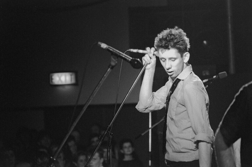 "Shane MacGowan onstage in 1988, from the documentary ""Crock of Gold: A Few Rounds With Shane MacGowan."""