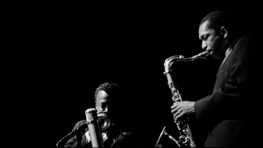 Miles Davis (left) and John Coltrane are shown performing at the Olympia Theatre in Paris on March 21, 1960. Already a budding solo star, Coltrane never again toured as a sideman.