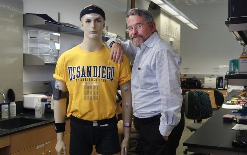 """Joseph Wang, Distinguished Professor in the Department of Nanoengineering at UCSD is one of the top developers of """"wearable technology."""" He is shown here with a mannequin displaying uses of such technology"""