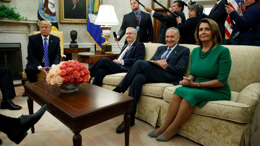 President Trump meets with, from left, Senate Majority Leader Mitch McConnell, Senate Minority Leader Charles Schumer and House Minority Leader Nancy Pelosi, along with other congressional leaders, at the White House in September.