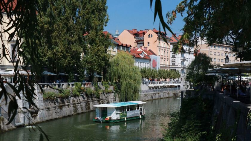 A placid canal runs through the middle of Ljubjana, making it a scenic and soothing place.