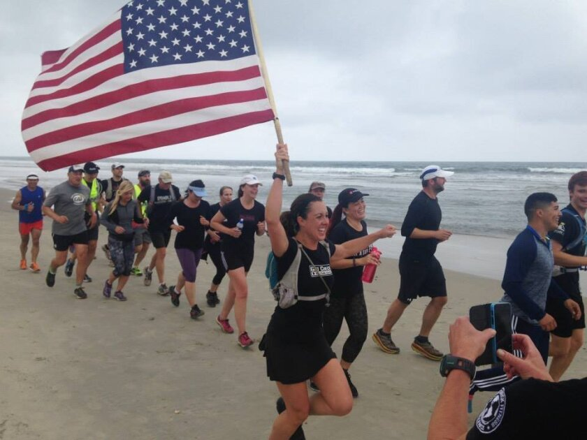 Gut Check Fitness' Memorial Day beach run honored the military and raised money for the Challenged Athletes Foundation's Operation Rebound. Courtesy photo
