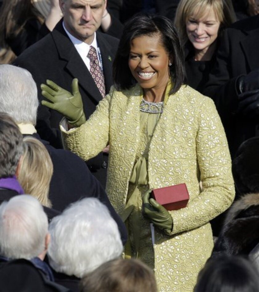 Michelle Obama arrives for the inauguration ceremony at the U.S. Capitol in Washington, Tuesday, Jan. 20, 2009.  (AP Photo/Jae C. Hong)