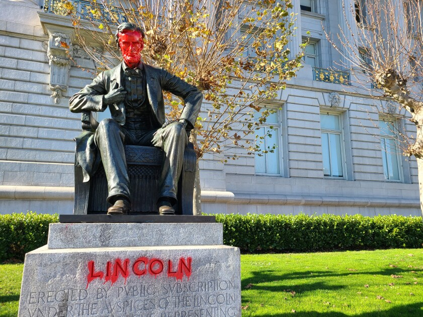 A statue of Abraham Lincoln in front of San Francisco City Hall was vandalized.
