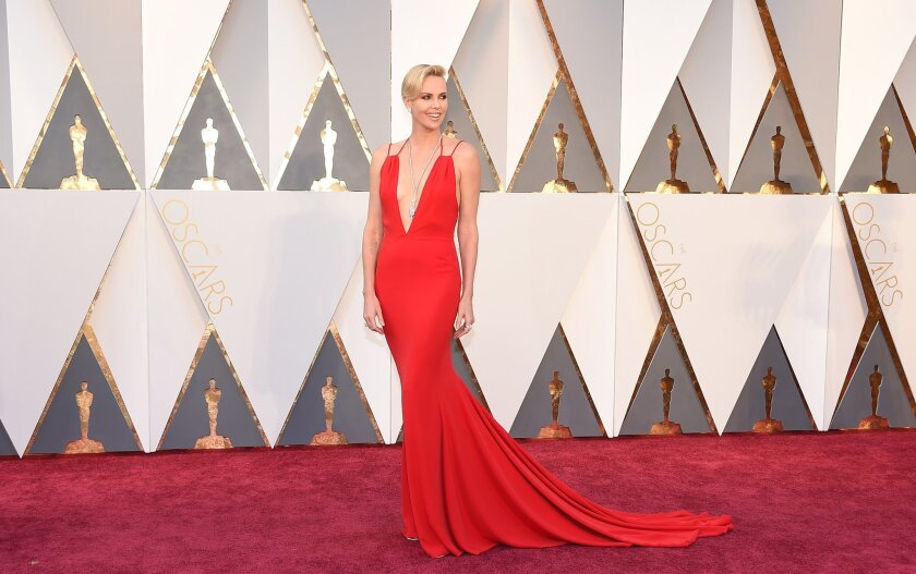 Charlize Theron arrives at the Oscars on Sunday, Feb. 28, 2016, at the Dolby Theatre in Los Angeles. (Photo by Jordan Strauss/Invision/AP)