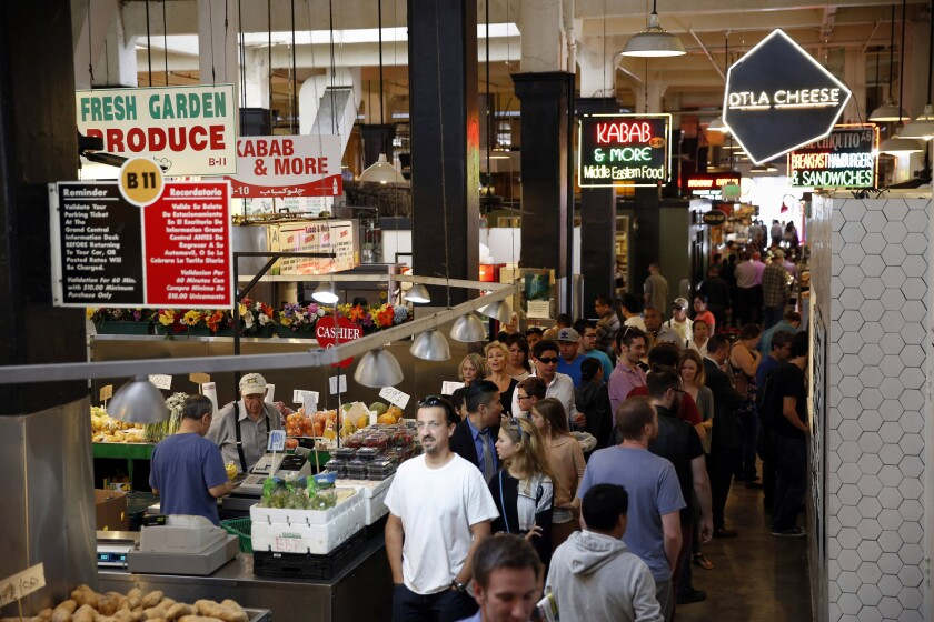 People shop at the Grand Central Market on April 14.