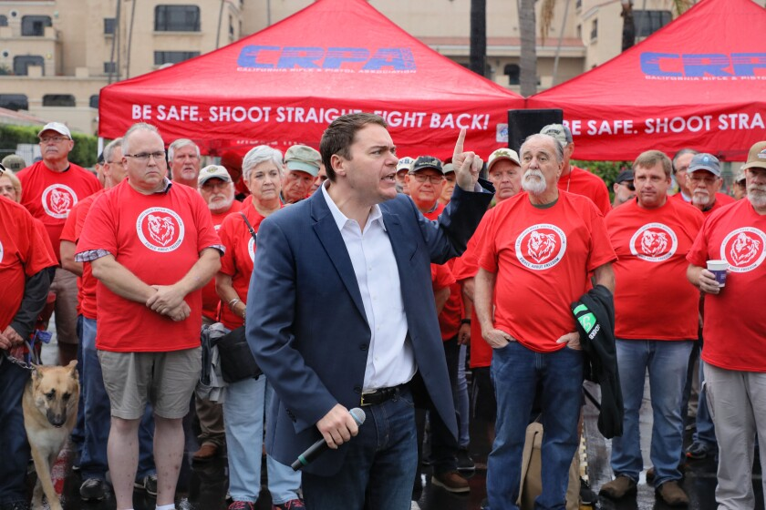 Carl DeMaio speaks at an early morning rally in September for the California Rifle & Pistol Association outside the entrance to the Crossroads of the West Gun Show at the Del Mar Fairgrounds. DeMaio has become well-known throughout the state as a fighter for Conservative causes.