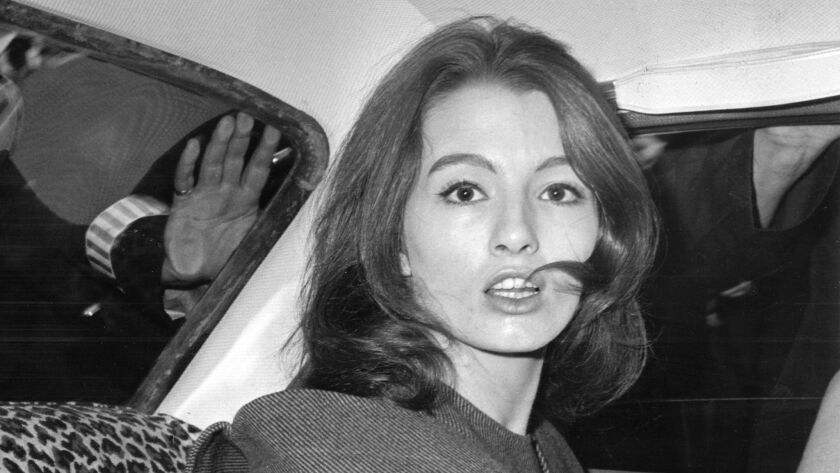 Christine Keeler became engulfed in scandal in 1963 when it was revealed that she had had affairs with Britain's War Secretary John Profumo and with a Soviet attache.