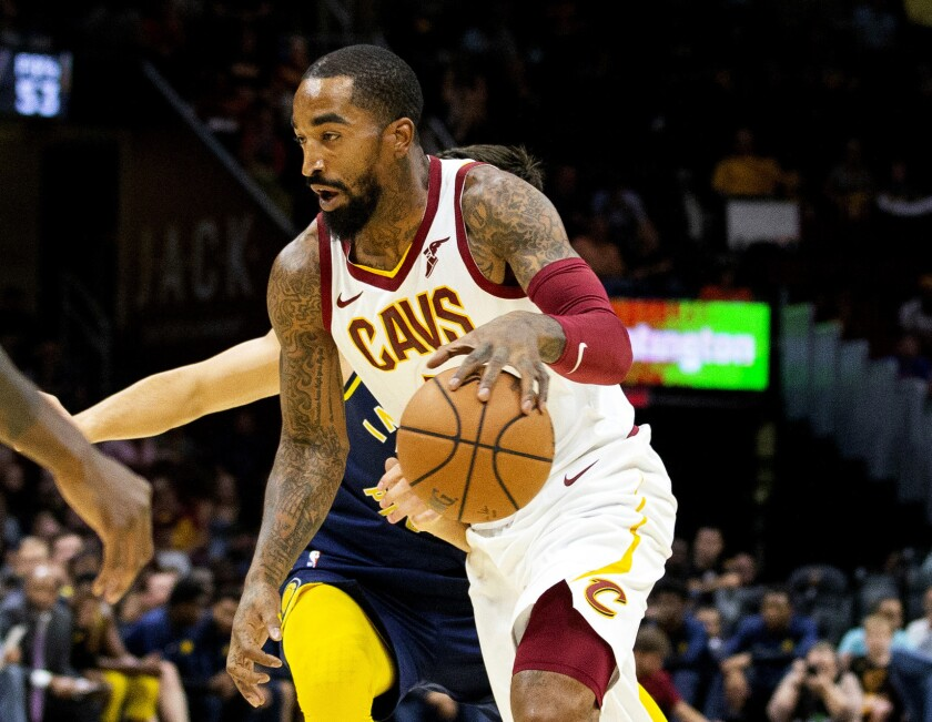 FILE - In this Oct. 8, 2018, file photo, Cleveland Cavaliers guard J.R. Smith dribbles to the basket during the first quarter of a preseason NBA basketball game against the Indiana Pacers in Cleveland. J.R. Smith has joined LeBron James and the Los Angeles Lakers for their championship push. The Lakers announced their long-anticipated signing of Smith as a substitute player on Wednesday, July 1, 2020, the first day allowed under the rules of the NBA's summer restart. (AP Photo/Scott R. Galvin, File)
