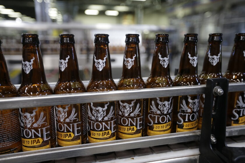 Workers brew, bottle and pack craft beer at Stone Brewery on Oct. 13, 2015, in Escondido, Calif.