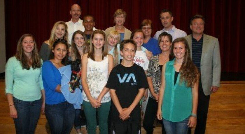 The R. Roger Rowe Middle School student council held an assembly on May 24 to present checks to nonprofits Helen Woodward Animal Center, Monarch School, Sole Hope and Lifeboats for Literacy with help from the Philanthropy Club Foundation. Photo/Karen Billing