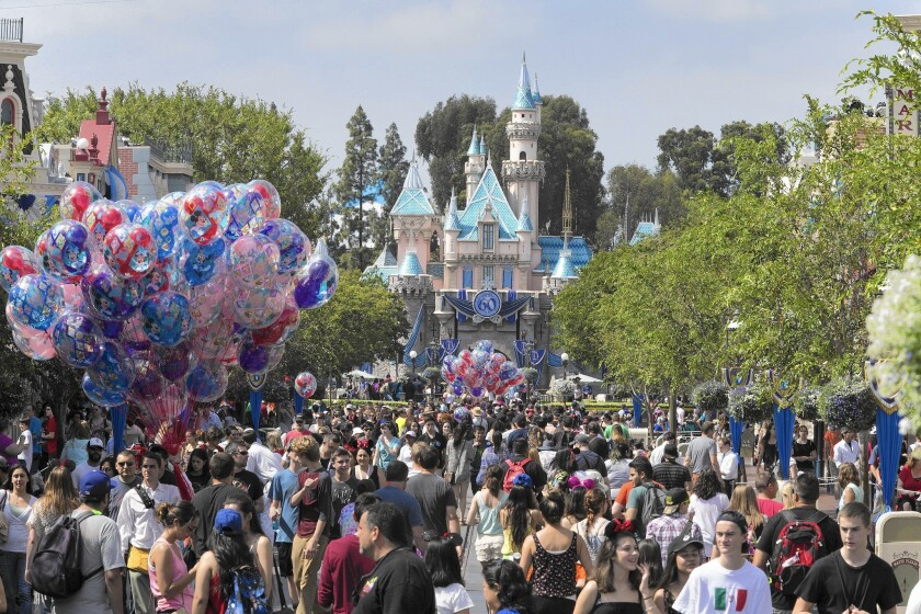 Under Disney's new pricing policy, visitors to Disneyland, above, and its other parks pay prices ranging from a 4% discount from regular prices on low-demand days to a 20% increase on the busiest days.