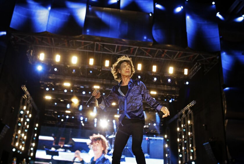 FILE - In this May 29, 2014 file photo, Mick Jagger of the British band Rolling Stones performs on the main stage of the Rock in Rio music festival, in Lisbon. The Stones will kick off a 15-city stadium tour of North America on May 24 at Petco Park in San Diego, Calif. (AP Photo/Francisco Seco) EDITORIAL USE ONLY