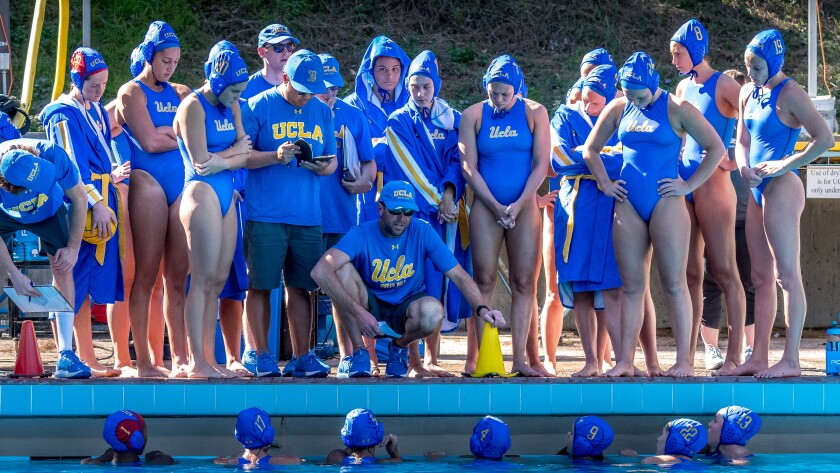 UCLA water polo coach Adam Wright speaks to the team.