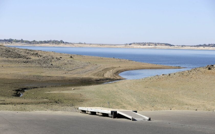 A dock sits high and dry at the end of a boat ramp yards away from the edge of Folsom Lake near Sacramento last October.