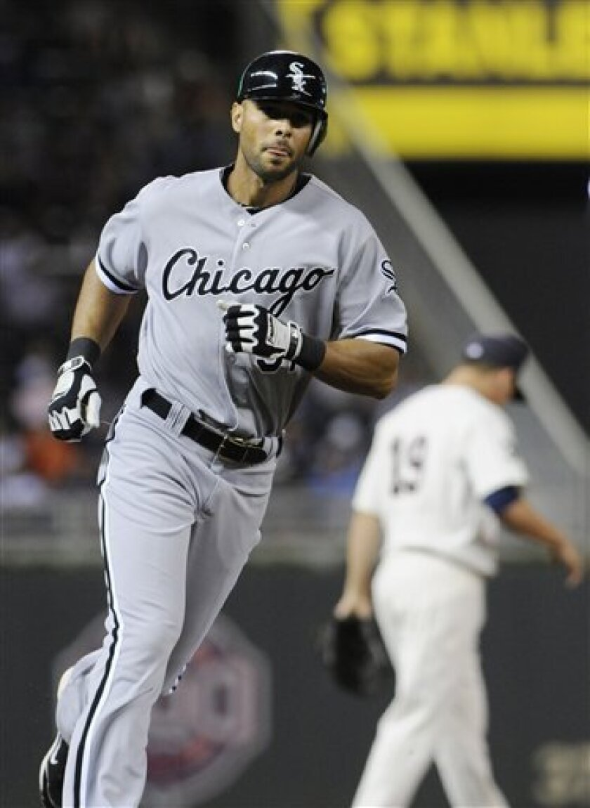 Chicago White Sox's Alex Rios rounds the bases on a solo home run off Minnesota Twins' pitcher Liam Hendriks during the fourth inning of a baseball game Tuesday, Sept. 6, 2011, in Minneapolis. (AP Photo/Jim Mone)
