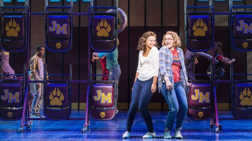 "Caitlin Kinnunen, right, is the girl banned from prom, and Isabelle McCalla is her closeted girlfriend in the fizzy musical ""The Prom,"" directed by Casey Nicholaw."