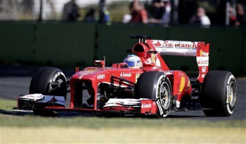 Ferrari driver Fernando Alonso of Spain controls his car on turn three during the second practice session for Sunday's Australian Formula One Grand Prix at Albert Park in Melbourne, Australia, Friday, March 15. Friday, 2013. (AP Photo/Rob Griffith)