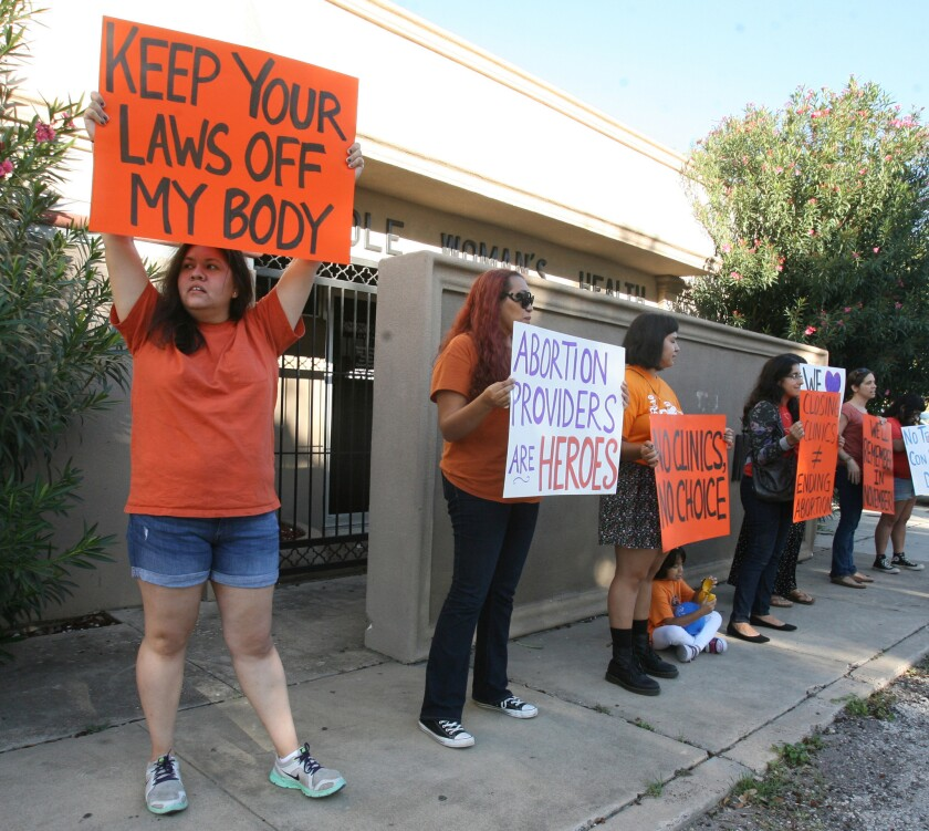 People protest in front of the Whole Women's Health clinic in McAllen, Texas.