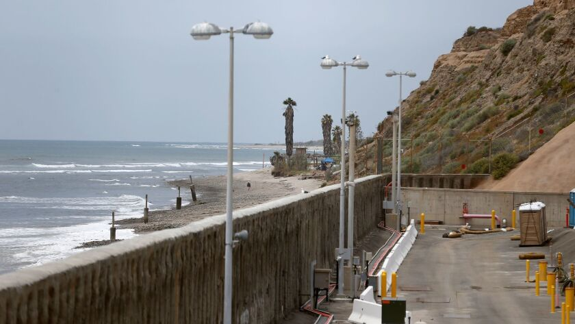 A view of the 28-foot sea wall, with San Onofre State Beach in the background, at the decommissioned