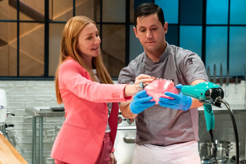 """""""Bake Squad"""" star Christian Tosi of Milk Bar works with contestant Christophe Rull on the Netflix competition series."""
